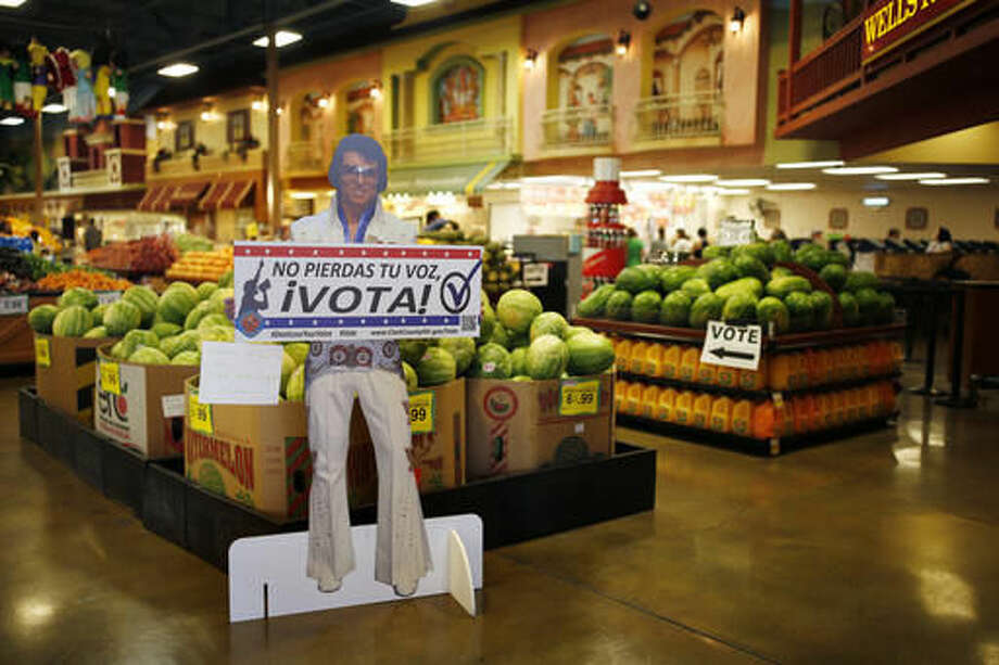 "A sign in Spanish which translates, ""Don't Lose Your Voice, Vote!"" is displayed near a polling place in a Cardenas supermarket in Las Vegas on Friday, June 10, 2016. In the battleground state of Nevada, some 17 percent of eligible voters are Hispanics. Here, Latinos have clearly demonstrated the power they wield when they either turn out or stay home. In 2008 and 2012 they helped President Barack Obama; they were critical in re-electing Sen. Harry Reid in 2010. In the 2014 midterms, though, Hispanic turnout plummeted, and Republicans swept every statewide office and won control of both houses of the Legislature for the first time since 1929. (AP Photo/John Locher)"