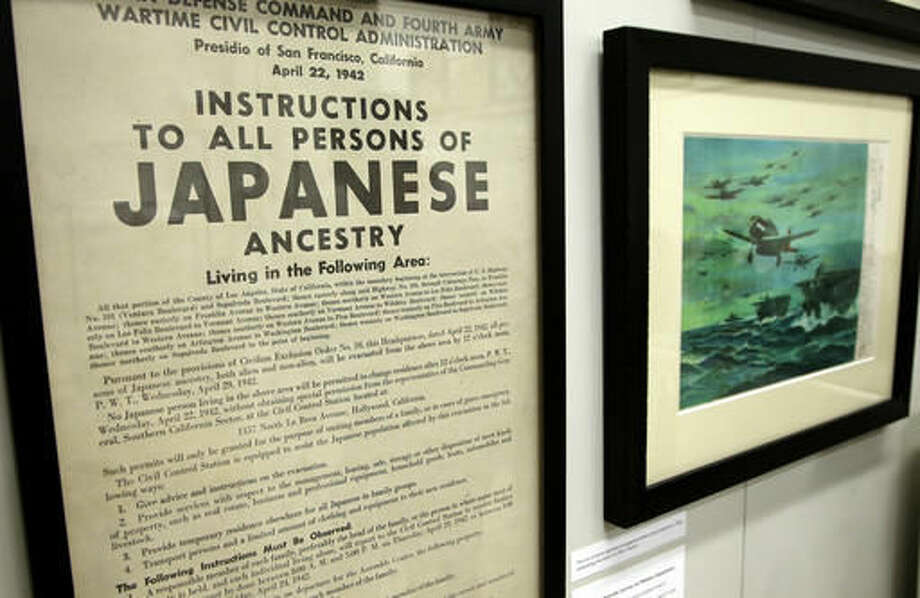 In this Tuesday, Oct. 4, 2016 photo a 1942 U.S. wartime poster that issues instructions to people of Japanese ancestry is on display as part of an exhibit at The Museum of World War II, Boston, in Natick, Mass. The new exhibition, which opened Saturday, Oct. 8, features artifacts that have rarely been publicly displayed. (AP Photo/Steven Senne)