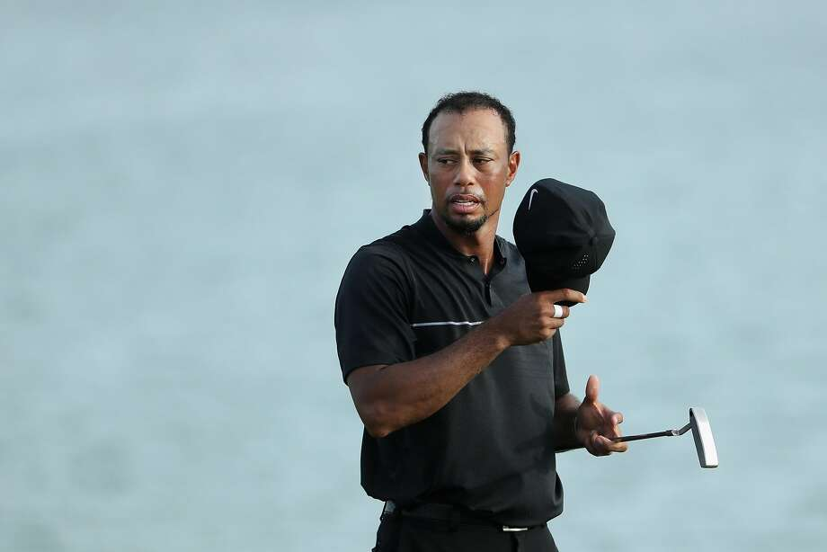 NASSAU, BAHAMAS - DECEMBER 01:  Tiger Woods of the United States takes his cap off on the 18th green during round one of the Hero World Challenge at Albany, The Bahamas on December 1, 2016 in Nassau, Bahamas.  (Photo by Christian Petersen/Getty Images) Photo: Christian Petersen, Getty Images