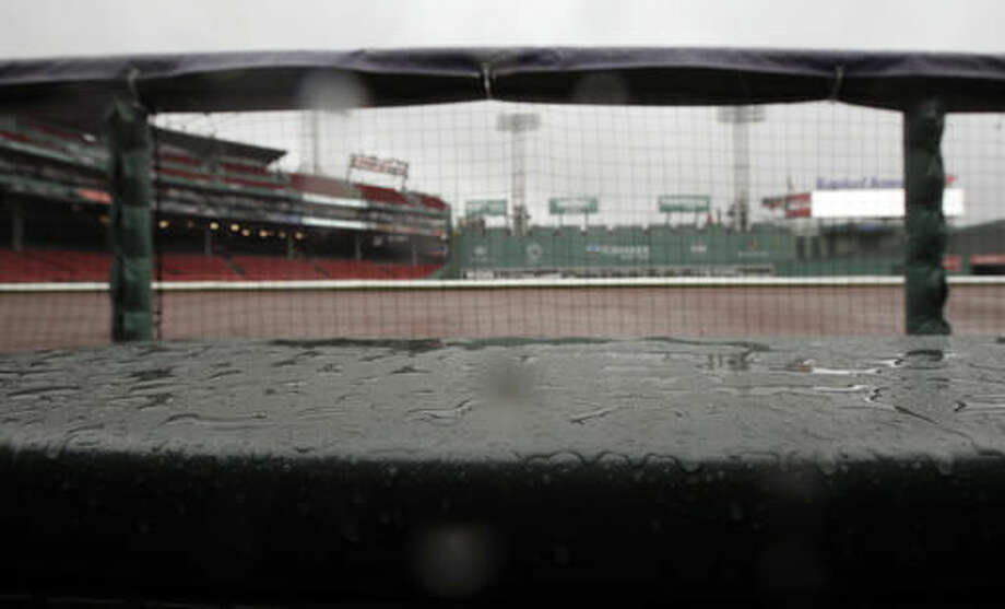 Puddles cover a ledge at Fenway Park during steady rain before Game 3 of baseball's American League Division Series between the Cleveland Indians and the Boston Red Sox, Sunday, Oct. 9, 2016, in Boston. (AP Photo/Charles Krupa)