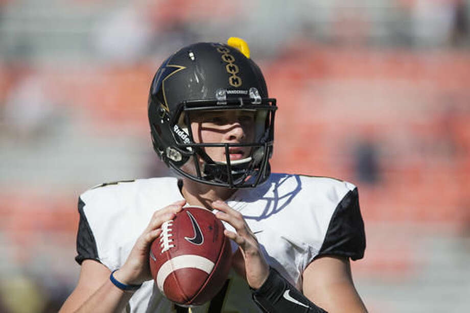 Vanderbilt quarterback Kyle Shurmur sets back to pass the ball during practice before the first half of an NCAA college football game against Auburn, Saturday, Nov. 5, 2016, in Auburn, Ala. (AP Photo/Brynn Anderson)