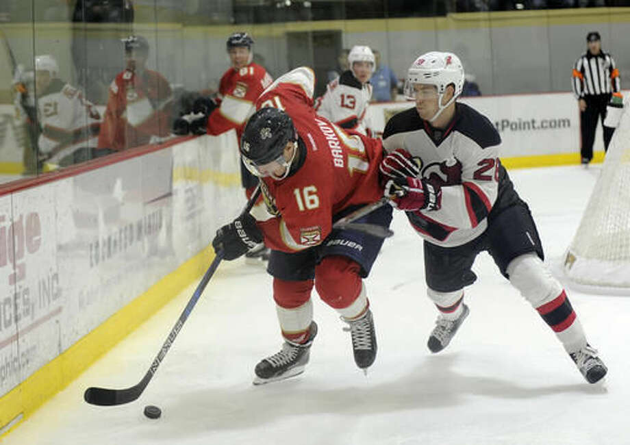 Florida Panthers center Aleksander Barkov (16), of Finland, moves the puck past New Jersey Devils defenseman Damon Severson (28) during the third period of an NHL preseason hockey game, Saturday, Oct. 8, 2016, in West Point, N.Y. The Panthers won 4-2.(AP Photo/Hans Pennink)