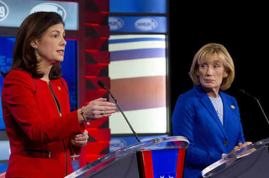 In this Nov. 2, 2016, photo, Sen. Kelly Ayotte, R-N.H., left, speaks as and Democratic challenger Gov. Maggie Hassan listens during a televised debate in Manchester, N.H. Control of the Senate hung in the balance Nov. 5 as candidates from Nevada to New Hampshire made their closing pitches to voters after a tough and costly campaign. (AP Photo/Jim Cole, Pool)