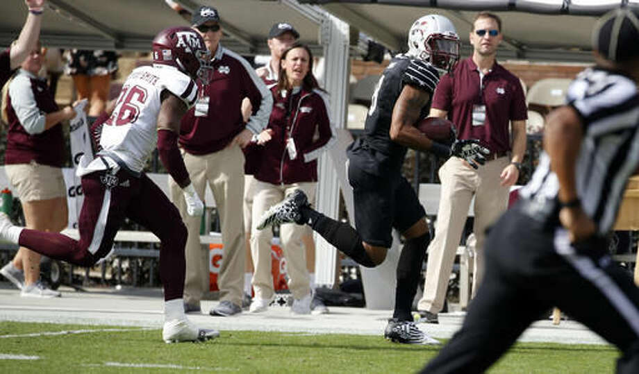 Mississippi State wide receiver Fred Ross (8) runs away from Texas A&M defensive back DeShawn Capers-Smith (26) for a 60-yard touchdown pass reception in the first half of an NCAA college football game in Starkville, Miss., Saturday, Nov. 5, 2016. (AP Photo/Rogelio V. Solis)