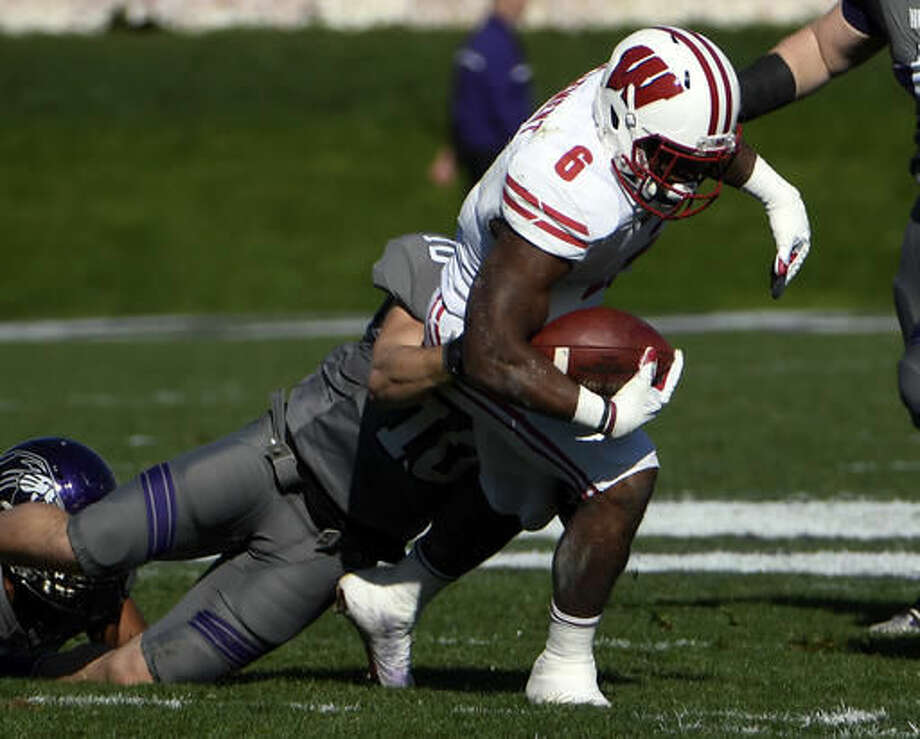 Wisconsin running back Corey Clement (6) is tackled by Northwestern linebacker Brett Walsh (10) during the first half of an NCAA college football game in Evanston, Ill., Saturday, Nov. 5, 2016. (AP Photo/David Banks)