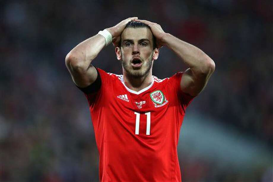 Wales' Gareth Bale reacts after coming close to scoring a second goal during the 2018 World Cup qualifying, group D soccer match, Wales versus Georgia at the Cardiff City Stadium, Cardiff, Wales, Sunday Oct. 9, 2016. (Nick Potts/PA via AP)
