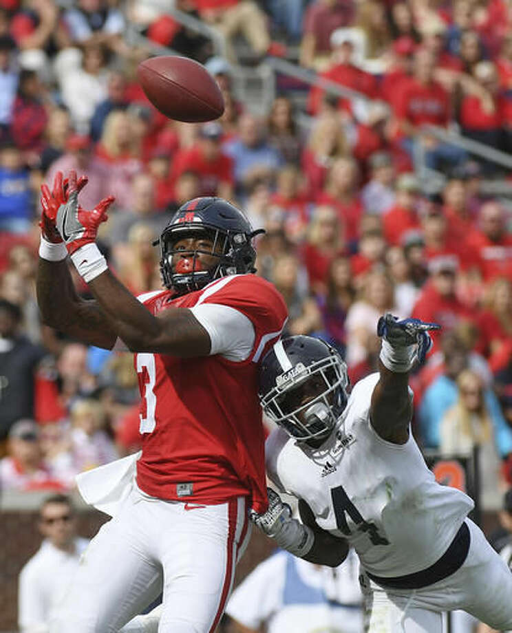 Georgia Southern cornerback Monquavion Brinson (4) breaks up a pass intended for Mississippi wide receiver Damore'ea Stringfellow (3) during the second half of an NCAA college football game in Oxford, Miss., Saturday, Nov. 5, 2016. Mississippi won 37-27. (AP Photo/Thomas Graning)