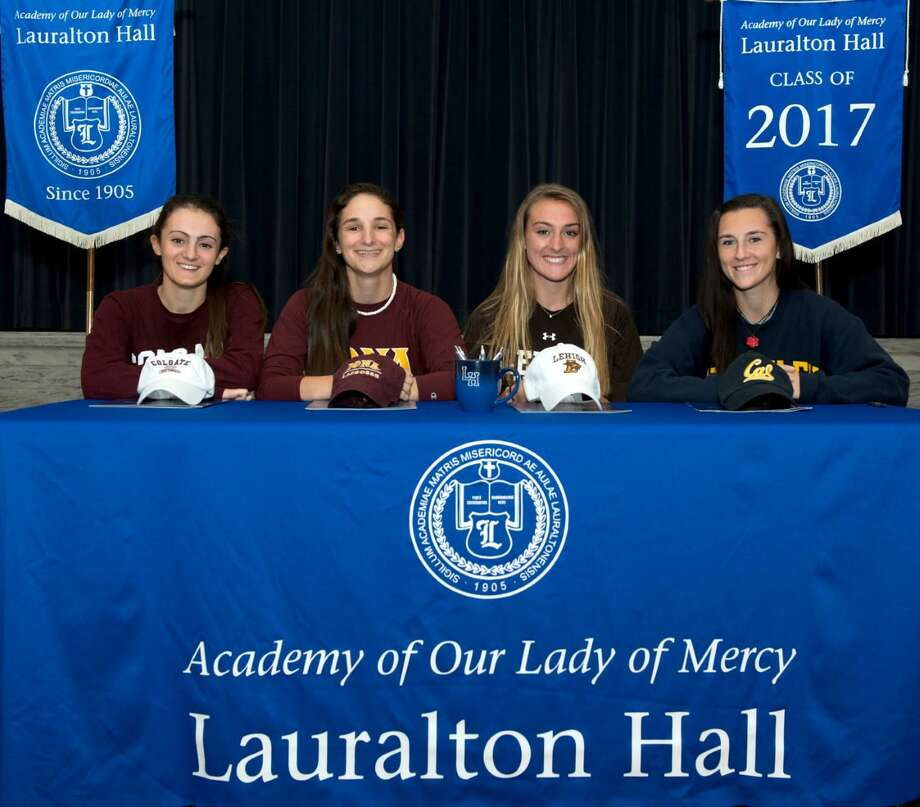 Four Lauralton Hall athletes accepted Division 1 scholarships at an official signing ceremony on Nov. 9 a the school in Milford. From left, Christiana Cottrell from Redding will attend Colgate to play softball; Elyse Darcy from Norwalk will attend Iona to play lacrosse and plans to major in entertainment studies; Madelyn Monahan from Fairfield will attend Lehigh to play field hockey and plans to major in business and engineering; and Nicole Zaccaro from Newtown will attend the University of California, Berkeley to play lacrosse. Photo: Contributed / Contributed Photo / Connecticut Post Contributed