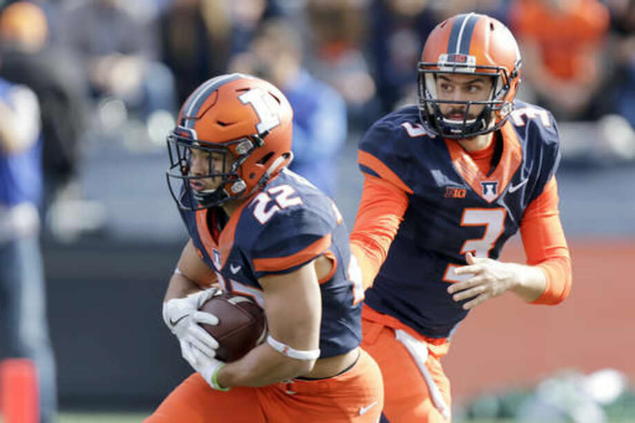 Illinois quarterback Jeff George Jr. (3) hands the ball off to running back Kendrick Foster (22) during the first half of an NCAA college football game against Michigan State at Memorial Stadium, Saturday, Nov. 5, 2016, in Champaign, Ill. (AP Photo/ Stephen Haas)