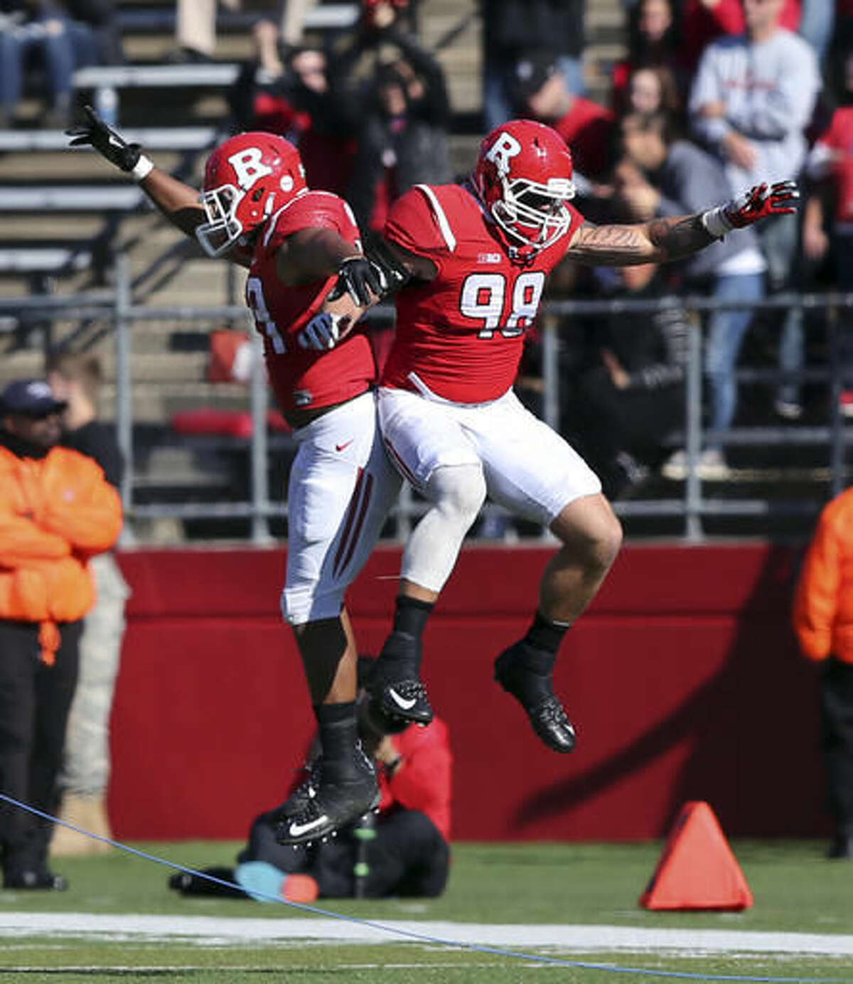 Rutgers defensive linemen Darnell Davis (59) and Jimmy Hogan (98) celebrate after Davis ran a fumble for a touchdown during the first half of a NCAA college football game against Indiana Saturday, Nov. 5, 2016, in Piscataway, N.J. (AP Photo/Mel Evans)