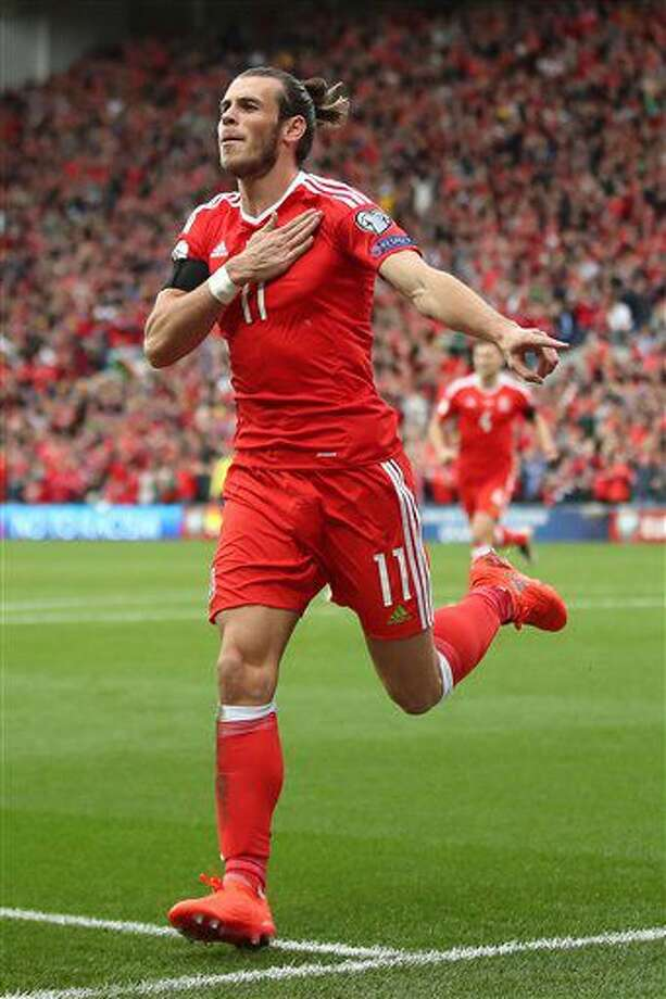 Wales' Gareth Bale celebrates scoring his side's first goal of the game during the 2018 World Cup qualifying, group D soccer match, Wales versus Georgia at the Cardiff City Stadium, Cardiff, Wales, Sunday Oct. 9, 2016. (Nick Potts/PA via AP)