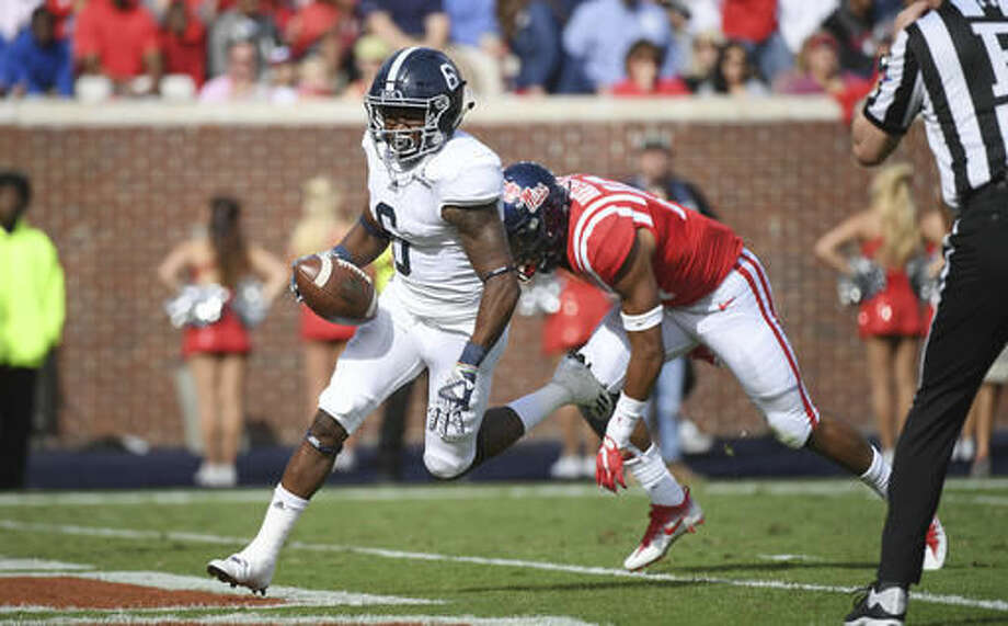 Georgia Southern wide receiver Myles Campbell (6) scores past Mississippi defensive back Myles Hartsfield (15) during the first quarter of an NCAA college football game in Oxford, Miss., Saturday, Nov. 5, 2016. (AP Photo/Thomas Graning)