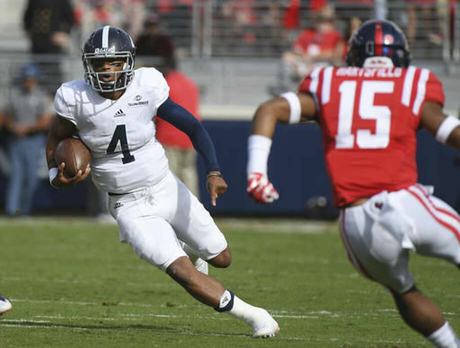 Georgia Southern quarterback Kevin Ellison (4) runs the ball as Mississippi defensive back Myles Hartsfield (15) closes in during the first quarter of an NCAA college football game in Oxford, Miss., Saturday, Nov. 5, 2016. (AP Photo/Thomas Graning)