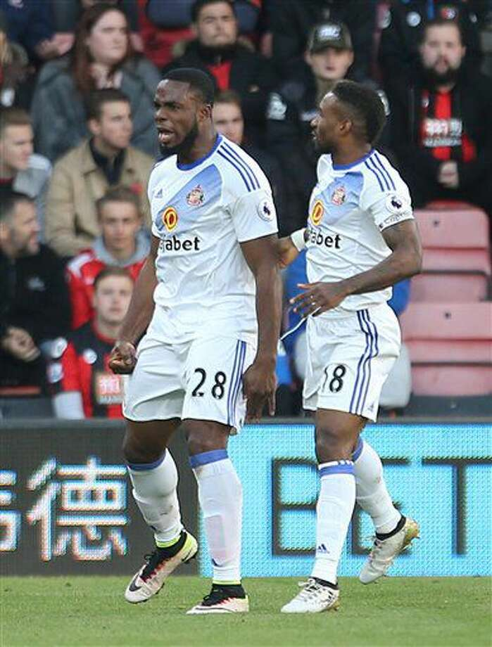 Sunderland's Victor Anichebe celebrates scoring his sides opening goal, with Jermain Defoe, right, against Bournemouth during their English Premier League soccer match at the Vitality Stadium, Bournemouth, England, Saturday Nov. 5, 2016. (Steven Paston / PA via AP)