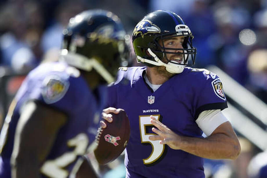 Baltimore Ravens' Joe Flacco looks to pass during the first half of an NFL football game against the Washington Redskins, Sunday, Oct. 9, 2016, in Baltimore. (AP Photo/Gail Burton)