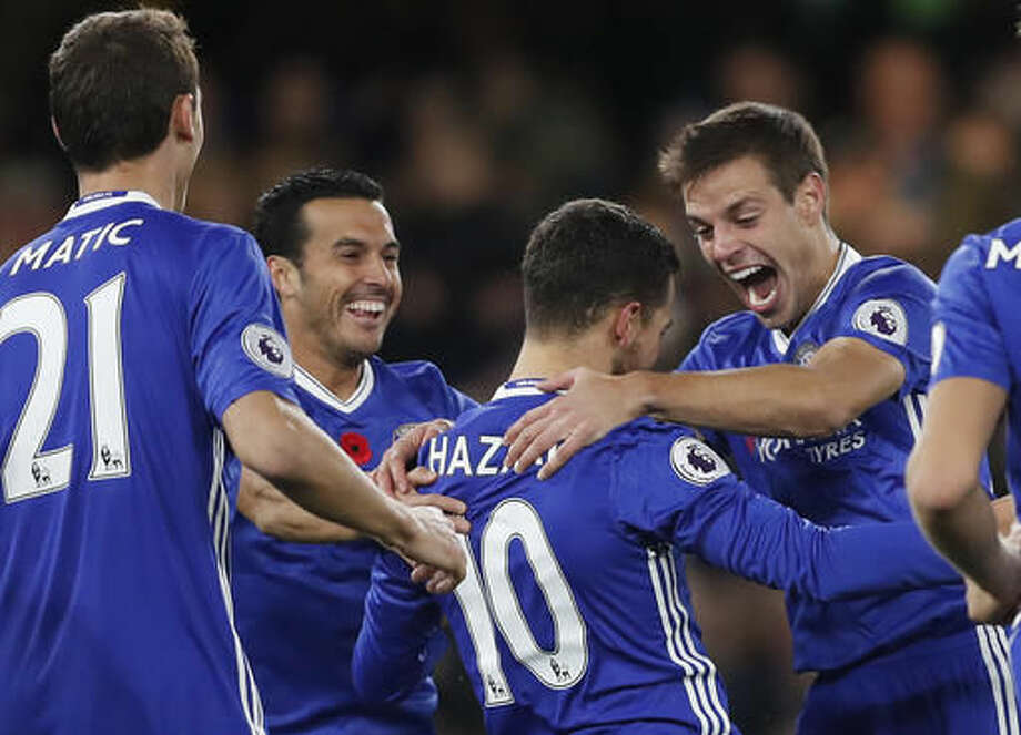 Chelsea's Eden Hazard, center right, and Cesar Azpilicueta, right, celebrates scoring a goal during the English Premier League soccer match between Chelsea and Everton at Stamford Bridge stadium in London, Saturday, Nov. 5, 2016. (AP Photo/Kirsty Wigglesworth)