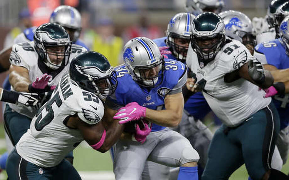 Detroit Lions fullback Zach Zenner (34) is tackled by Philadelphia Eagles defensive end Brandon Graham (55) during the first half of an NFL football game, Sunday, Oct. 9, 2016, in Detroit. (AP Photo/Duane Burleson)
