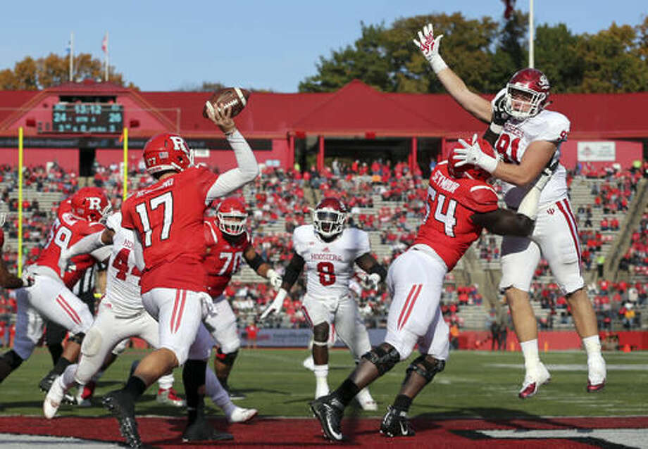 Indiana defensive lineman Jacob Robinson (91) gets a hand up to block as Rutgers quarterback Giovanni Rescigno (17) throws a pass during the second half of a NCAA college football game Saturday, Nov. 5, 2016, in Piscataway, N.J. Indiana won 33-27. (AP Photo/Mel Evans)