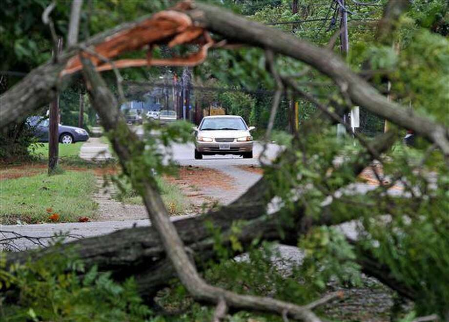 A vehicle drives along Shell Road in Hampton, Va., Sunday, Oct. 9, 2016, after Hurricane Matthew knocked down many trees on Saturday night. (Aileen Devlin/The Daily Press via AP)