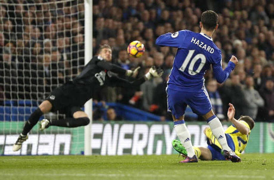 Chelsea's Eden Hazard has a shot on goal blocked by Everton's goalkeeper Maarten Stekelenburg during the English Premier League soccer match between Chelsea and Everton at Stamford Bridge stadium in London, Saturday, Nov. 5, 2016. (AP Photo/Kirsty Wigglesworth)