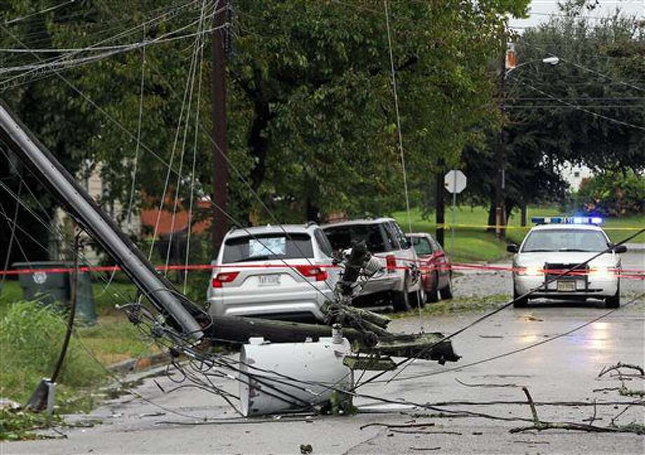 Power lines are scattered over 21st Street near Chestnut Avenue after Hurricane Matthew left thousands without power in Newport News, Va., on Sunday, Oct. 9, 2016. (Aileen Devlin/The Daily Press via AP)