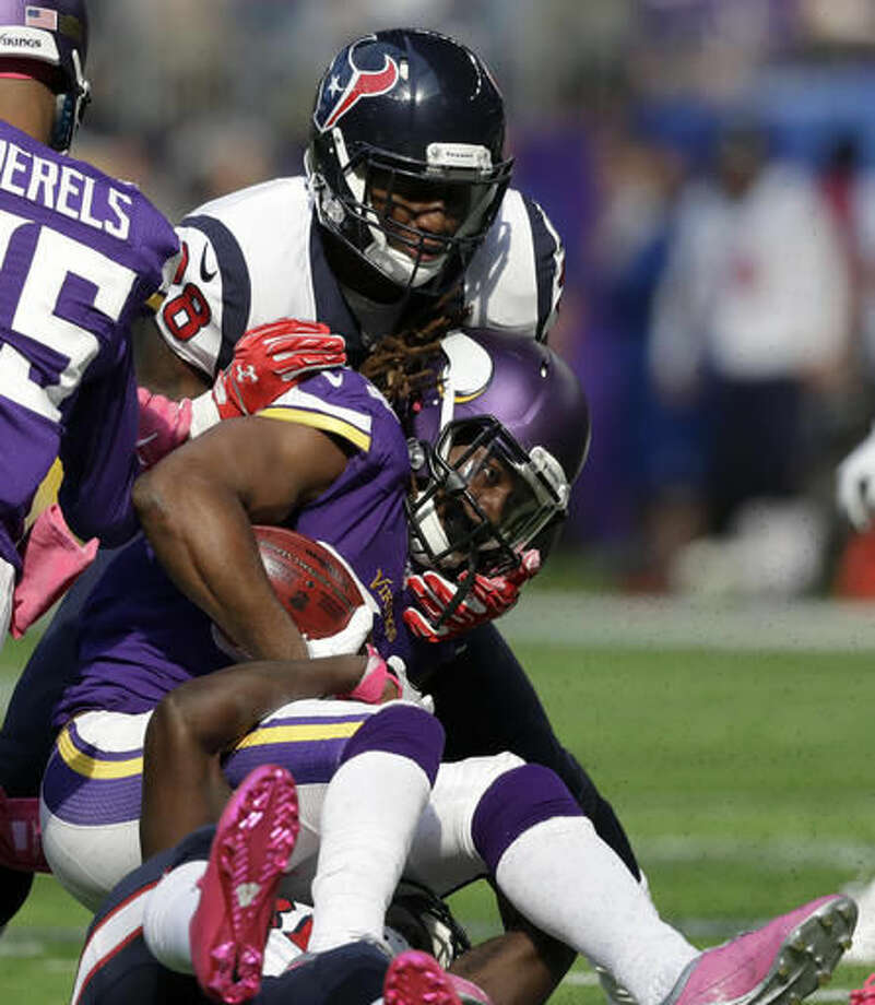 Minnesota Vikings wide receiver Cordarrelle Patterson is tackled by Houston Texans' Alfred Blue, top, during the first half of an NFL football game Sunday, Oct. 9, 2016, in Minneapolis. (AP Photo/Charlie Neibergall)