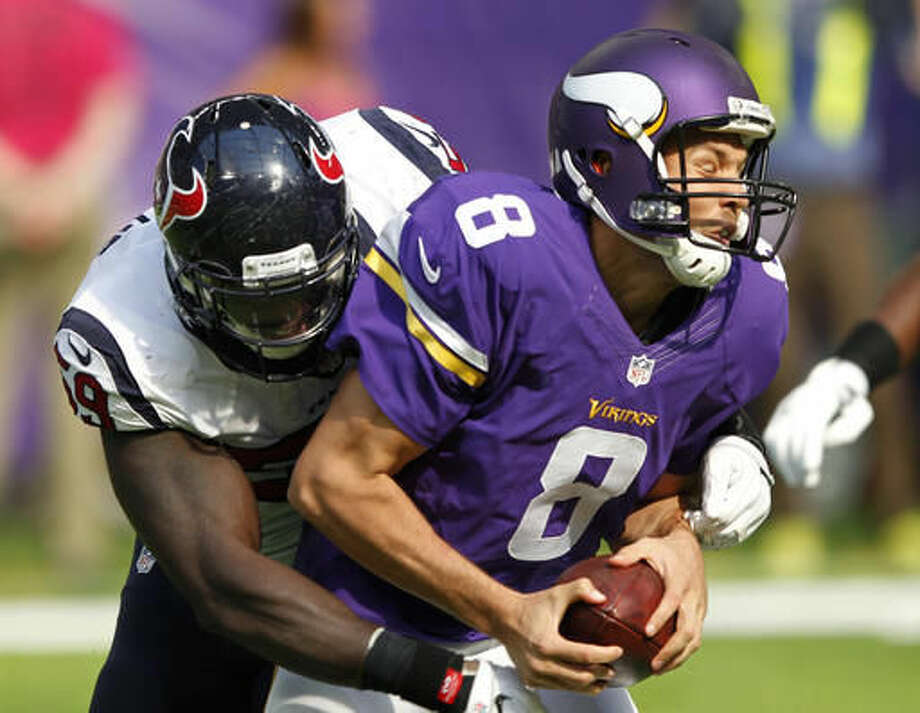 Minnesota Vikings quarterback Sam Bradford (8) is sacked by Houston Texans outside linebacker Whitney Mercilus, left, during the first half of an NFL football game, Sunday, Oct. 9, 2016, in Minneapolis. (AP Photo/Andy Clayton-King)