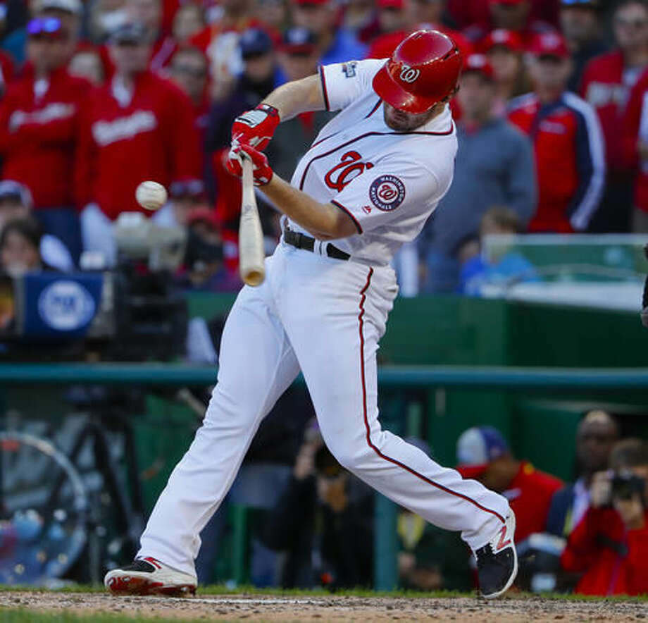 Washington Nationals' Daniel Murphy hits an RBI single against the Los Angeles Dodgers during the seventh inning in Game 2 of baseball's National League Division Series at Nationals Park, Sunday, Oct. 9, 2016, in Washington. (AP Photo/Pablo Martinez Monsivais)