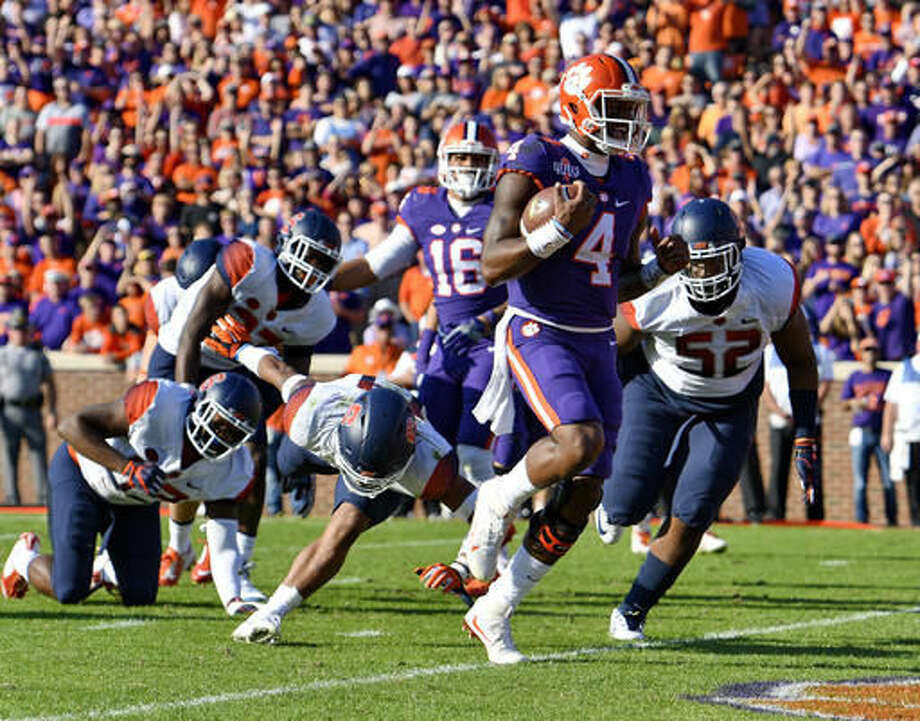 Clemson quarterback Deshaun Watson scores a touchdown during the first half of an NCAA college football game against Syracuse, Saturday, Nov. 5, 2016, in Clemson, S.C. (AP Photo/Richard Shiro)