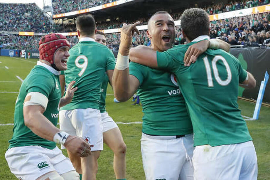 Ireland's Simon Zebo, second from right, celebrates with Johnny Sexton, right, after scoring against New Zealand during the second half of a rugby match Saturday, Nov. 5, 2016, in Chicago. (AP Photo/Kamil Krzaczynski)