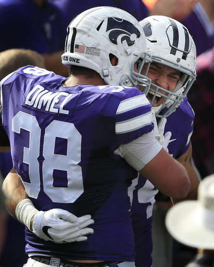 Kansas State running back Alex Barnes, back, congratulates fullback Winston Dimel (38) on his touchdown during the first half of an NCAA college football game against Oklahoma State in Manhattan, Kan., Saturday, Nov. 5, 2016. (AP Photo/Orlin Wagner)