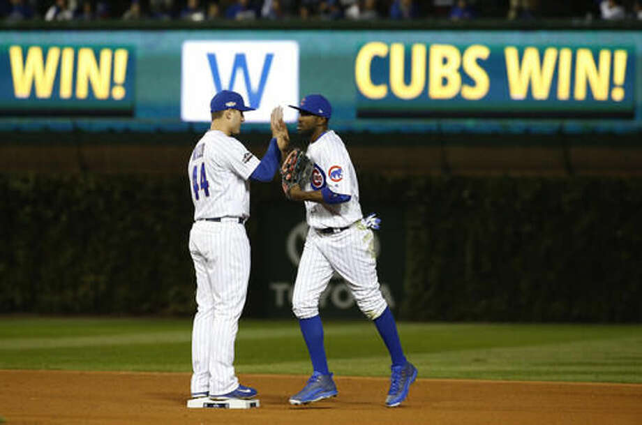 Chicago Cubs' Anthony Rizzo (44) celebrates with Dexter Fowler after Game 2 of baseball's National League Division Series against the San Francisco Giants, Saturday, Oct. 8, 2016, in Chicago. The Cubs won 5-2. (AP Photo/Nam Y. Huh)