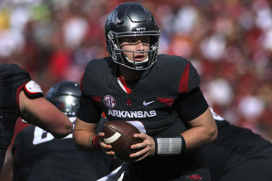 Arkansas' Austin Allen (8) looks to hand off during the first half of an NCAA college football game against Florida Saturday, Nov. 5, 2016, in Fayetteville, Ark. (AP Photo/Samantha Baker)