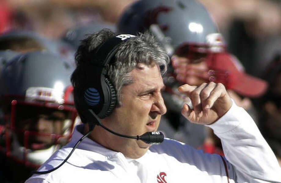 Washington State head coach Mike Leach directs his team during the first half of an NCAA college football game against Arizona in Pullman, Wash., Saturday, Nov. 5, 2016. (AP Photo/Young Kwak)