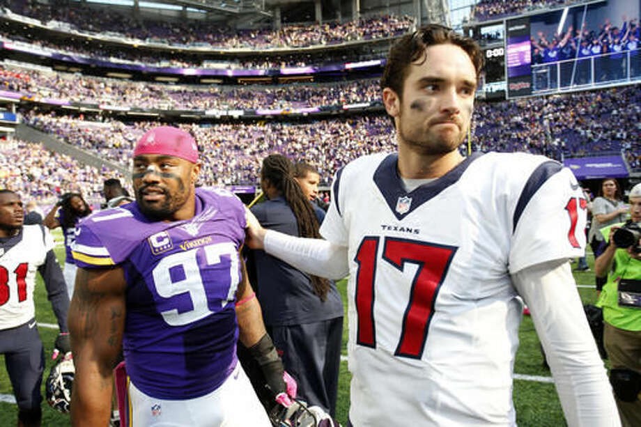 Minnesota Vikings defensive end Everson Griffen, left, talks with Houston Texans quarterback Brock Osweiler, right, after an NFL football game Sunday, Oct. 9, 2016, in Minneapolis. (AP Photo/Andy Clayton-King)