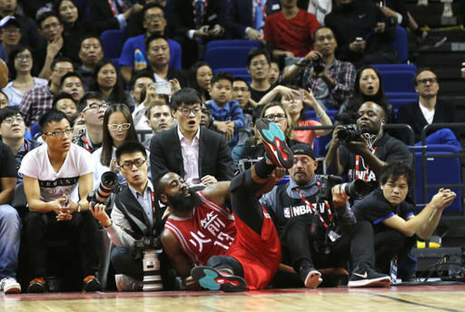 ba8e468a349 Houston Rockets James Harden falls into the crowd during their preseason  NBA game against the New