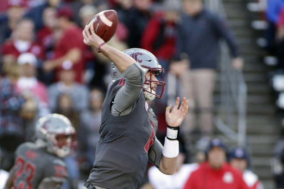 Washington State quarterback Luke Falk passes the ball during the first half of an NCAA college football game against Arizona in Pullman, Wash., Saturday, Nov. 5, 2016. (AP Photo/Young Kwak)