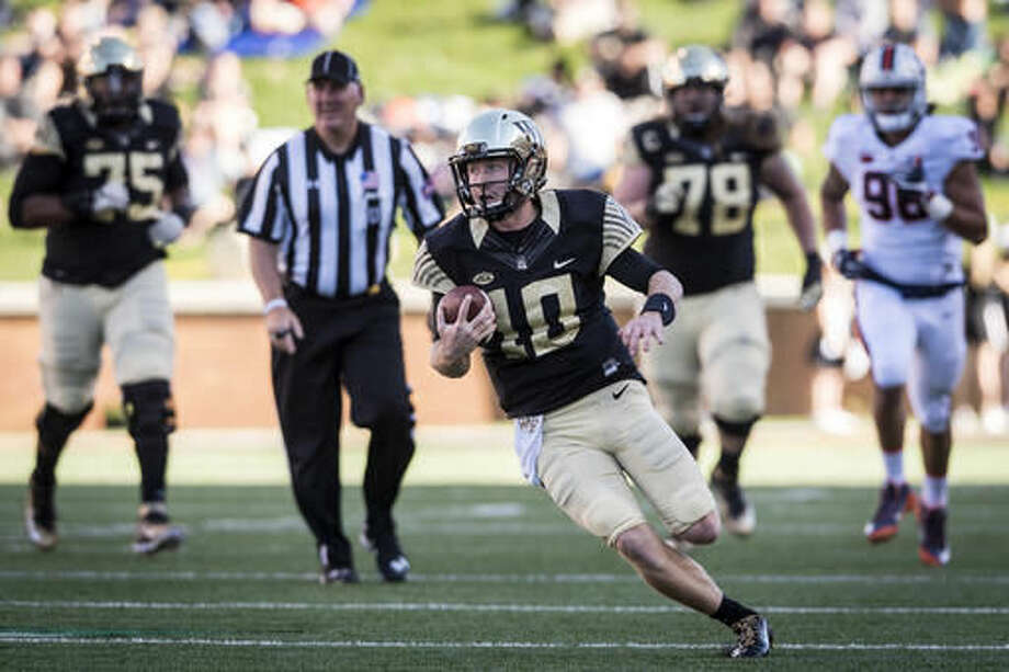 Wake Forest junior quarterback John Wolford (10) runs for a touchdown during an NCAA college football game against Virginia, Saturday, Nov. 5, 2016 in Winston-Salem, N.C. (Andrew Dye/The Winston-Salem Journal via AP)