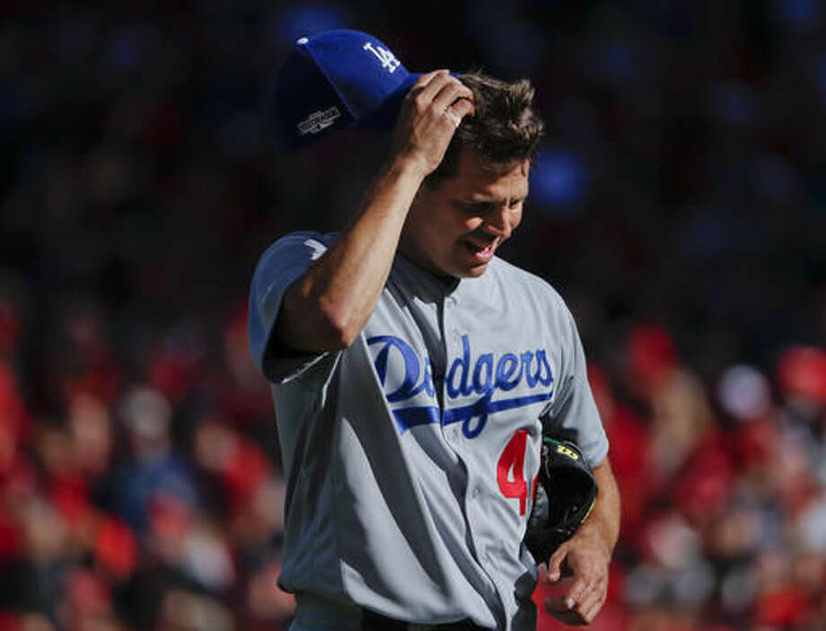 Los Angeles Dodgers starting pitcher Rich Hill scratches his head as he is taken out of the fifth inning in Game 2 of baseball's National League Division Series against the Washington Nationals at Nationals Park, Sunday, Oct. 9, 2016, in Washington. (AP Photo/Pablo Martinez Monsivais)