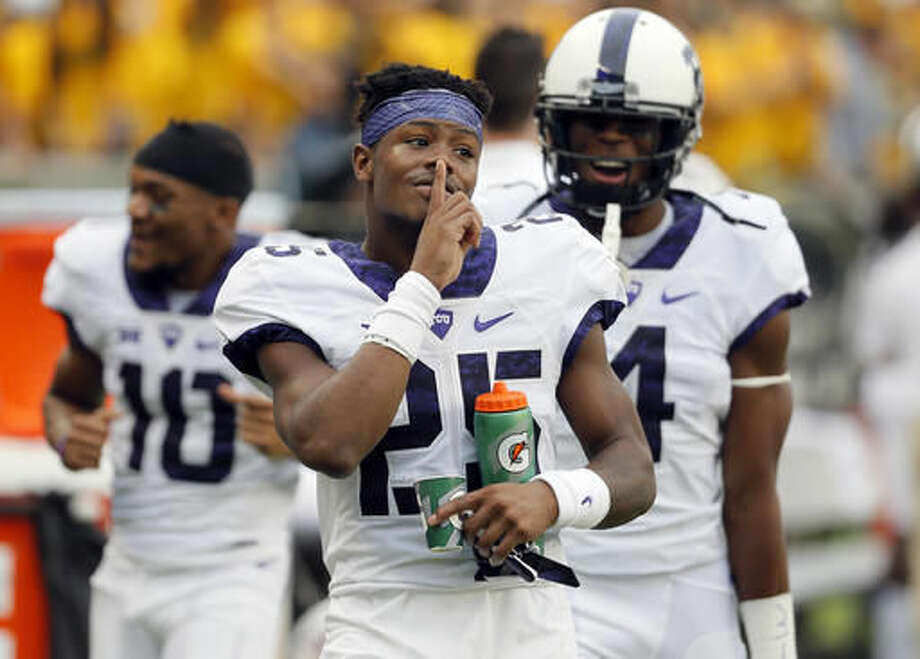 TCU wide receiver KaVontae Turpin (25) gestures his finger to his lips as he celebrates after teammate Ranthony Texada, not pictured, intercepted a Baylor Seth Russell pass and ran it back for a touchdown in the first half of an NCAA college football game, Saturday, Nov. 5, 2016, in Waco, Texas. (AP Photo/Tony Gutierrez)