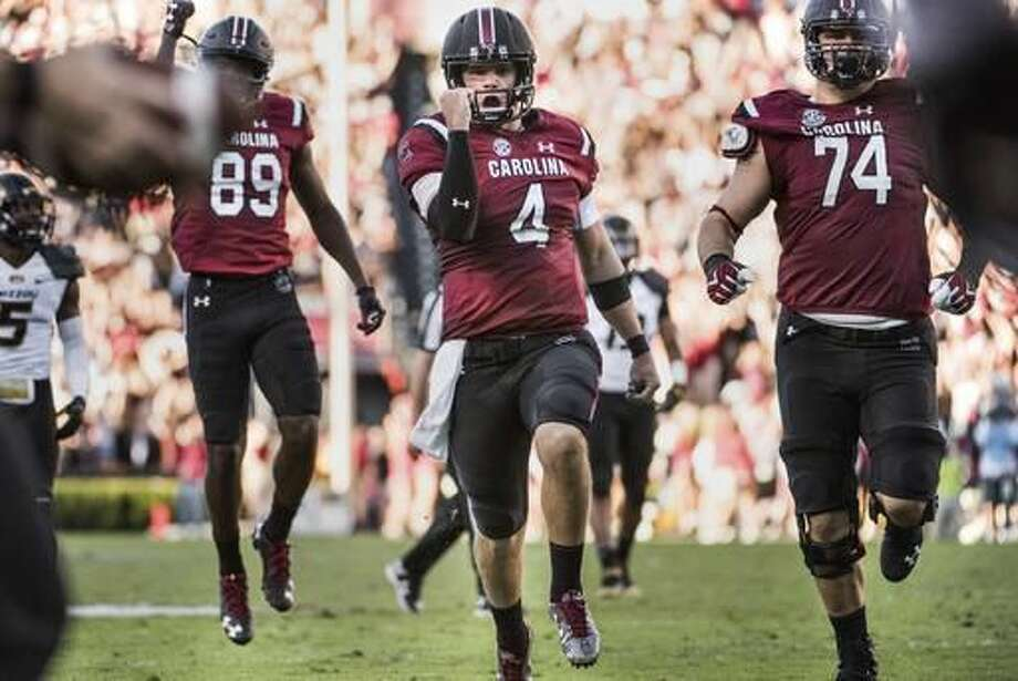 South Carolina quarterback Jake Bentley celebrates a touchdown during the first half of an NCAA college football game against Missouri Saturday, Nov. 5, 2016, in Columbia, S.C. (AP Photo/Sean Rayford)