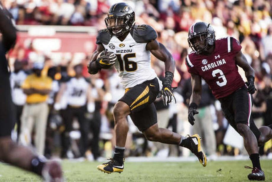 Missouri running back Damarea Crockett (16) runs for a touchdown during the first half of an NCAA college football game against South Carolina Saturday, Nov. 5, 2016, in Columbia, S.C. (AP Photo/Sean Rayford)