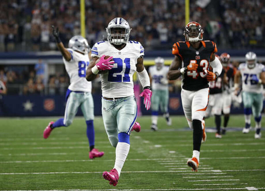 Dallas Cowboys running back Ezekiel Elliott (21) approaches the end zone after a long run for a touchdown as Cincinnati Bengals free safety George Iloka (43) gives chase in the second half of an NFL football game, Sunday, Oct. 9, 2016, in Arlington, Texas. (AP Photo/Ron Jenkins)
