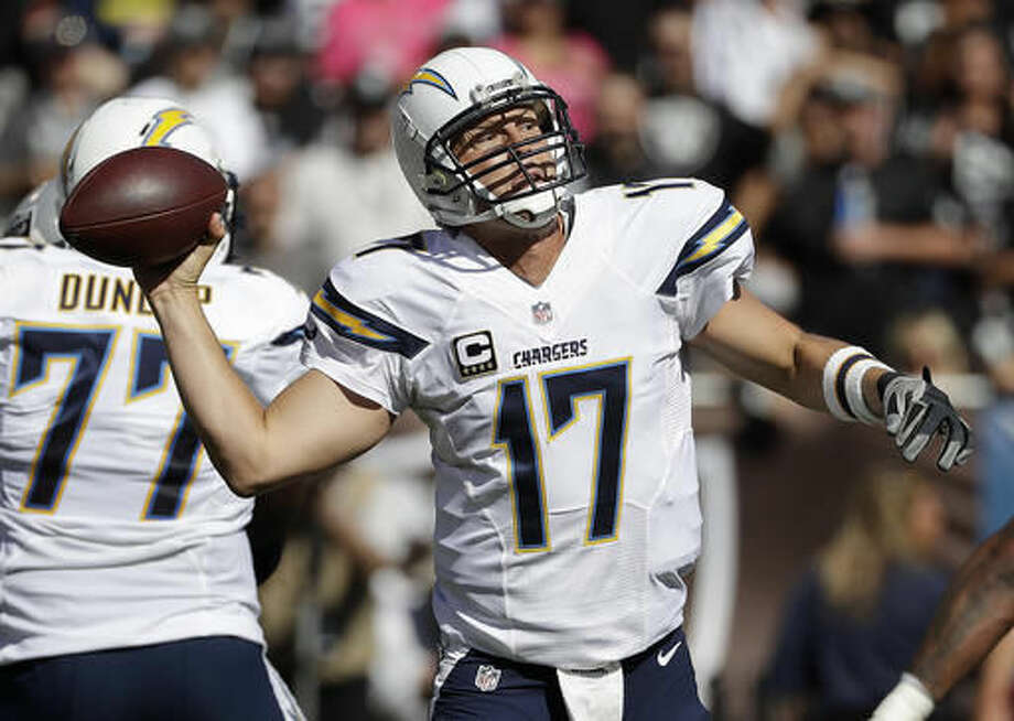 San Diego Chargers quarterback Philip Rivers (17) passes against the Oakland Raiders during the first half of an NFL football game in Oakland, Calif., Sunday, Oct. 9, 2016. (AP Photo/Marcio Jose Sanchez)