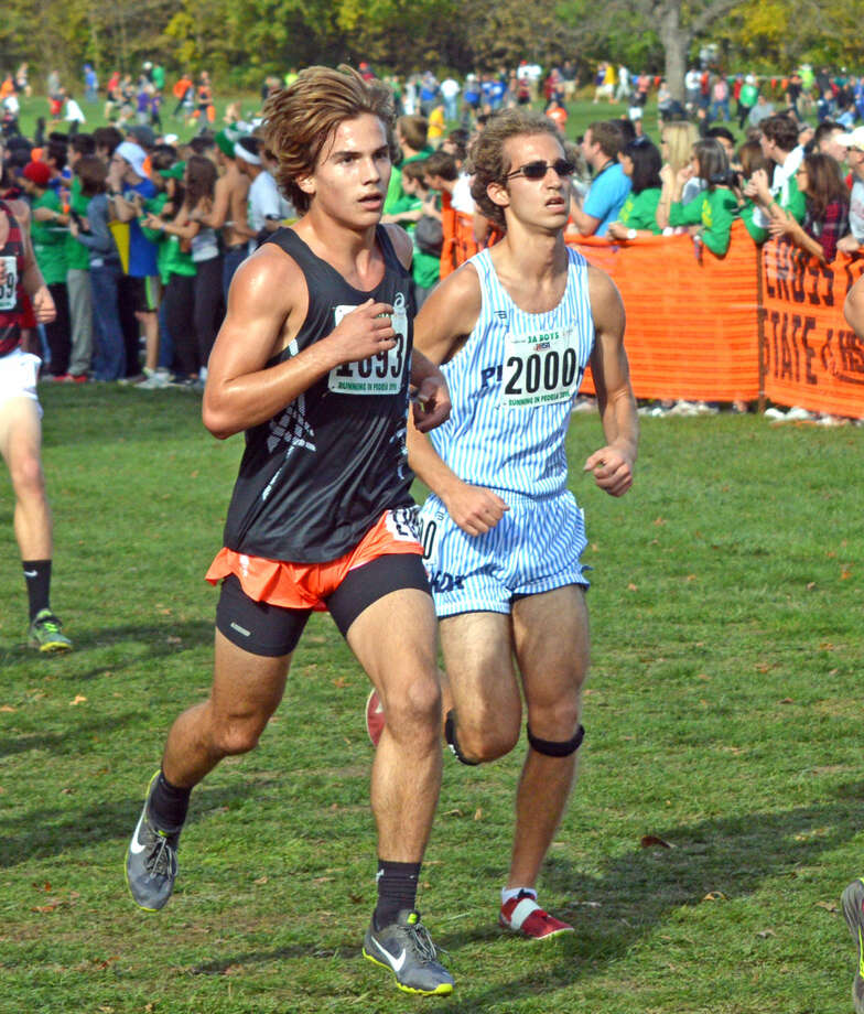 Edwardsville junior Franky Romano, left, competes in the Class 3A boys' race.