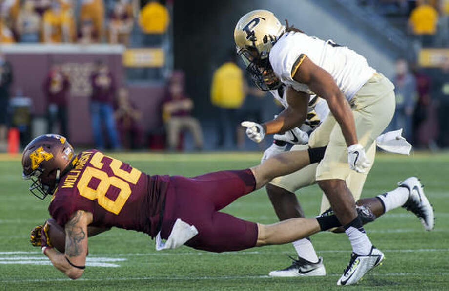 Minnesota wide receiver Drew Wolitarsky (82) is brought down by Purdue safety Leroy Clark (3) after a 13-yard catch and run during the second half of an NCAA college football game, Saturday, Nov. 5, 2016, in Minneapolis. (AP Photo/Paul Battaglia)