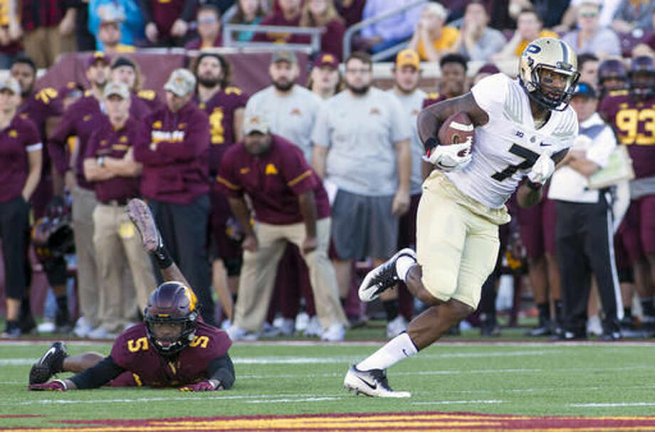 Purdue wide receiver DeAngelo Yancey (7) heads to the end zone on a 69-yard touchdown catch and run during the first half of an NCAA college football game against Minnesota, Saturday, Nov. 5, 2016, in Minneapolis. Minnesota defensive back Jalen Myrick (5) defends on the play. (AP Photo/Paul Battaglia)