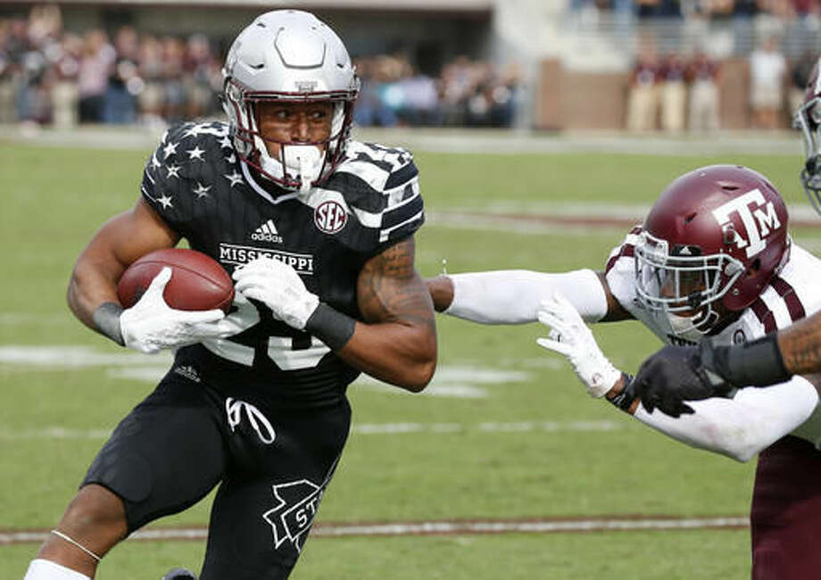 Mississippi State wide receiver Keith Mixon (23) runs upfield past a Texas A&M defender for a short yardage reception during the second half of their NCAA college football game in Starkville, Miss., Saturday, Nov. 5, 2016. Mississippi State won 35-28. (AP Photo/Rogelio V. Solis)