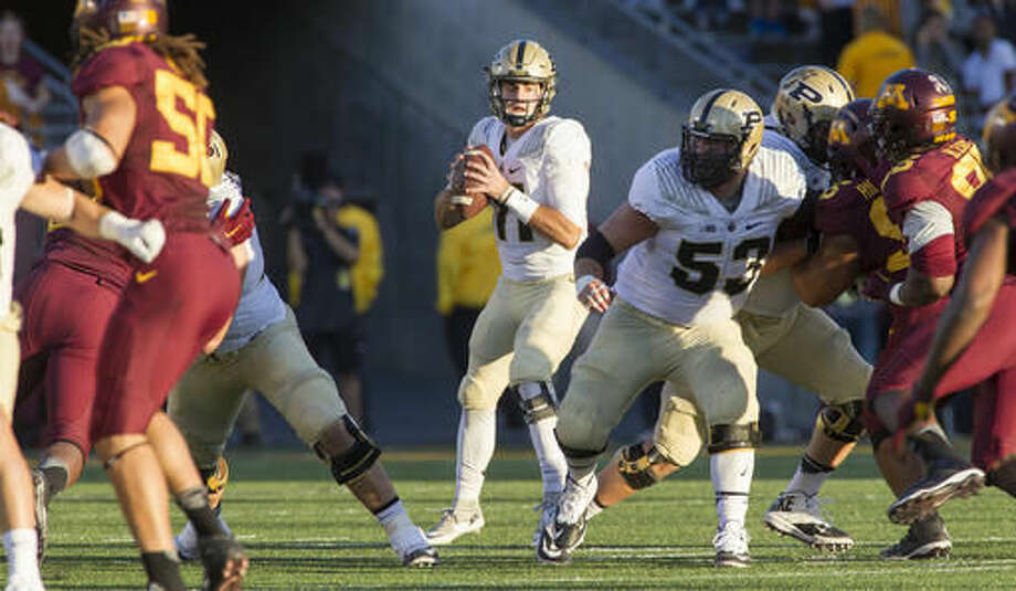 Purdue quarterback David Blough (11) looks to pass against Minnesota during the second half of an NCAA college football game, Saturday, Nov. 5, 2016, in Minneapolis. (AP Photo/Paul Battaglia)