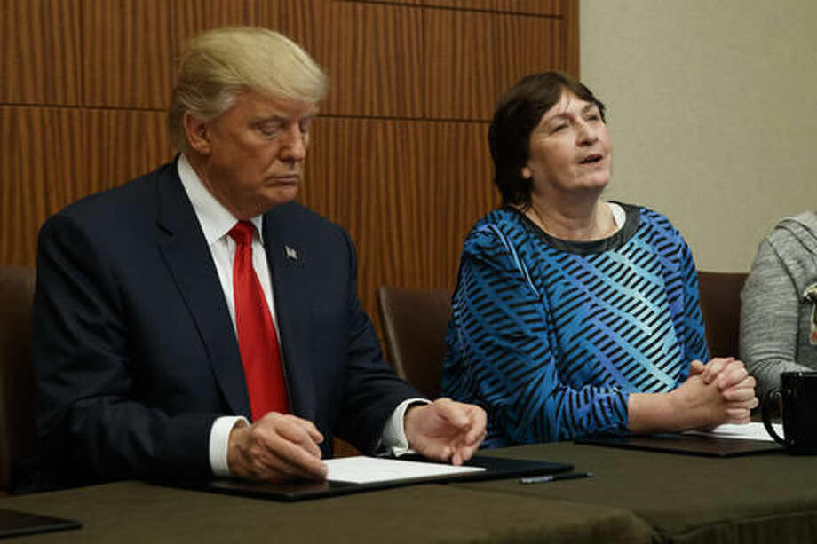 Republican presidential candidate Donald Trump, left, listens as Kathy Shelton makes remarks before the second presidential debate with democratic presidential candidate Hillary Clinton at Washington University, Sunday, Oct. 9, 2016, in St. Louis. (AP Photo/ Evan Vucci)